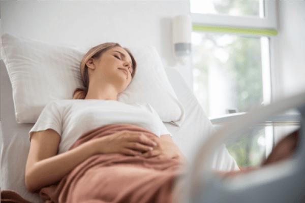 Woman recovering after uterine artery embolization procedure