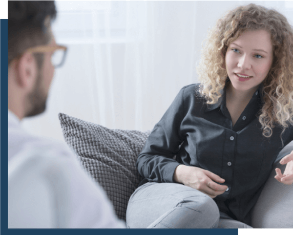 Woman discussing surgical vs. non-surgical fibroid treatment options with Fibroid Specialist