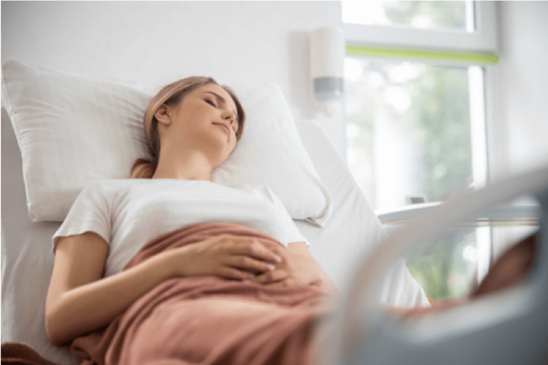 Woman in recovery after fibroid surgery removal